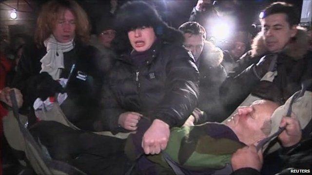 Vladimir Neklyaev being lifted into an ambulance