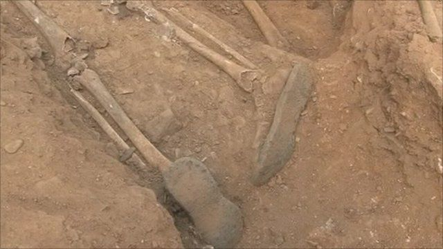 Skeleton in mass grave