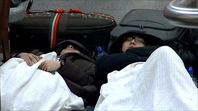 Delayed travellers sleeping