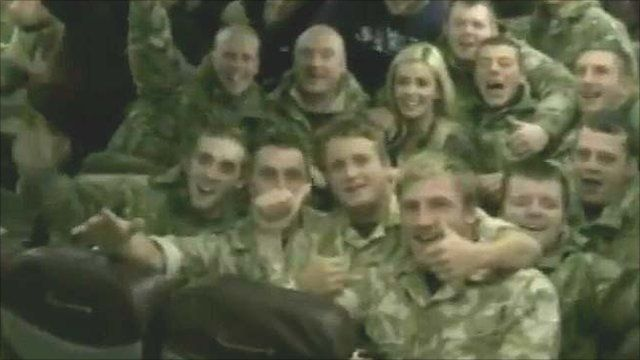 Katherine Jenkins with troops on the plane