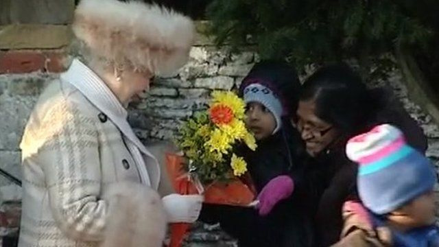Queen accepts flowers from people at Sandringham