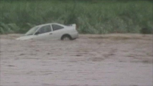 Submerged car in floodwaters