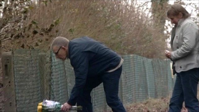 Miss Yeates' parents lay flowers at the scene where her body was found