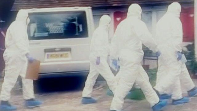 Forensic team in protective clothing