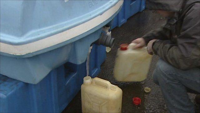 Man filling water bottle