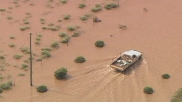 Truck driving through floods