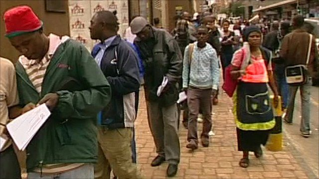 Queues of Zimbabweans outside government offices in South Africa