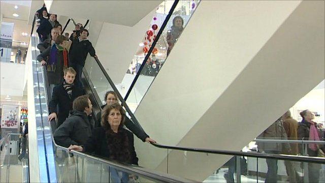 Shoppers on an escalator