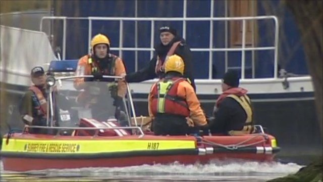 Police divers search for missing men