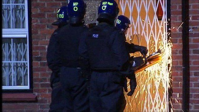 Police use machine to cut through railings