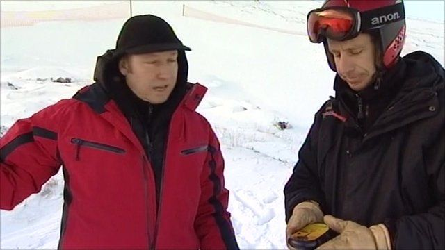 Craig Anderson talking to Keith Hill with a transceiver