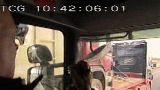 Motorway policeman using camera