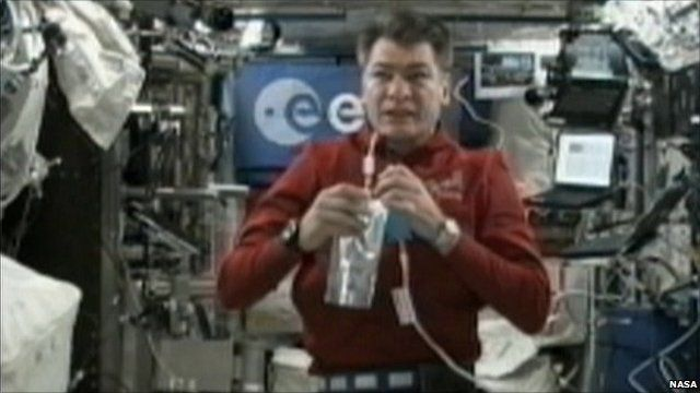 Astronaut Paolo Nespoli holding a water bottle on board the ISS