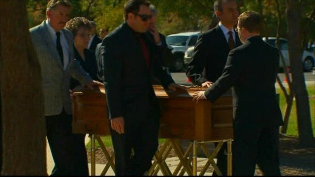 Christina's coffin being wheeled into church