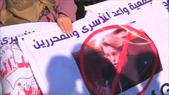 Banner protesting French minister's visit to Gaza