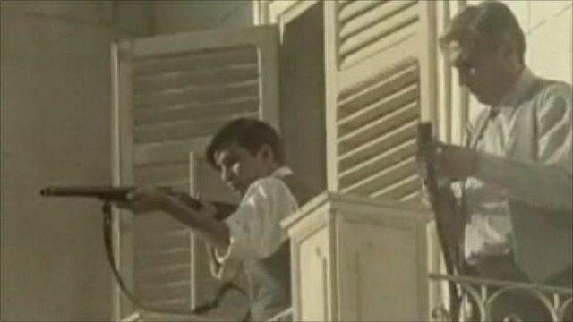 Screenshot from film - men with guns