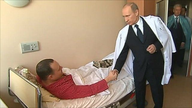 PM Putin meets an injured man in hospital