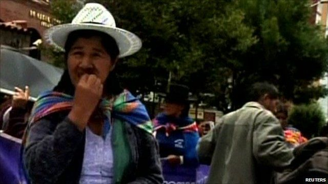 Bolivian protester chewing coca leaf