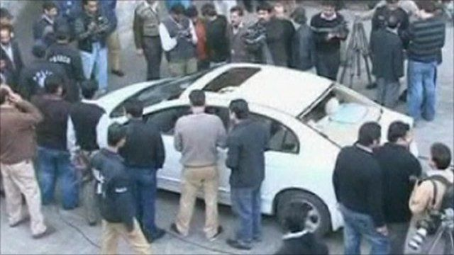 People surrounding the car