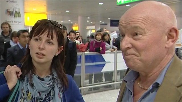 Two passengers who have just arrived back in the UK from Cairo
