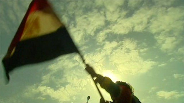 Protester waving Egyptian flag