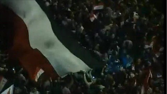 Protesters waving the flag