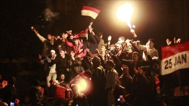 Protesters celebrate the resignation of Egyptian President Hosni Mubarak