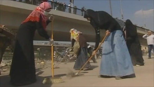 Egyptian women cleaning streets