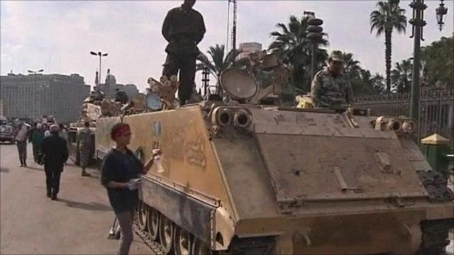 Demonstrator wiping down a tank