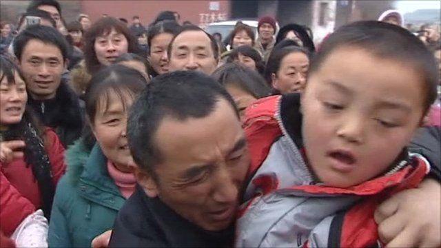 Crowds greeting returned boy