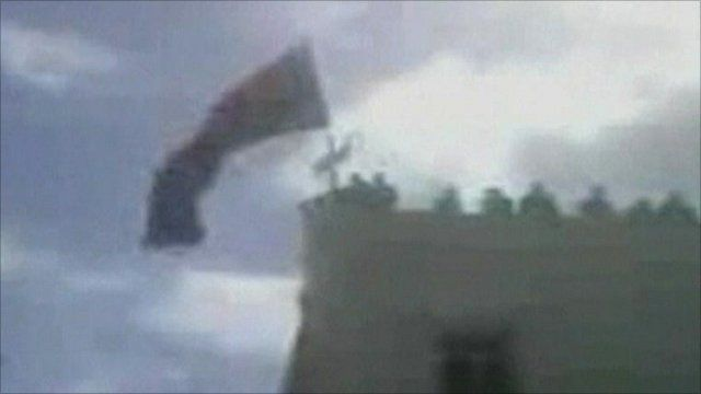 Amateur video purportedly showed the flag of independence being raised in Benghazi