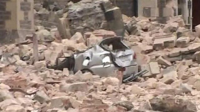Car buried under rubble in Christchurch