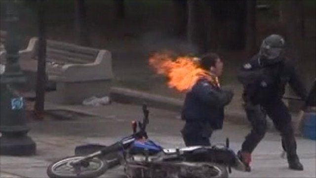 Police officer hit by a petrol bomb