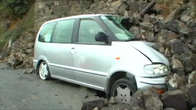 Vehicle crushed under rocks