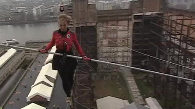 Blue Peter presenter Helen Skelton walking a tightrope between the chimneys of Battersea Power Station