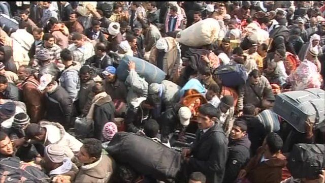 Thousands wait to cross the border
