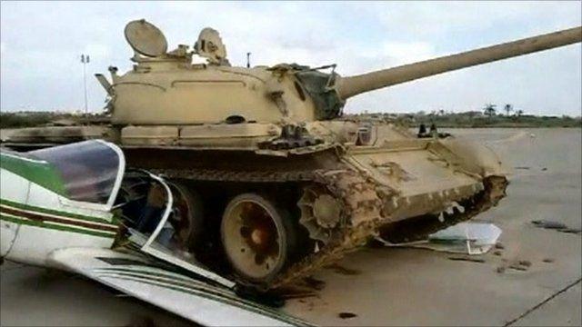 A tank crushing a plane