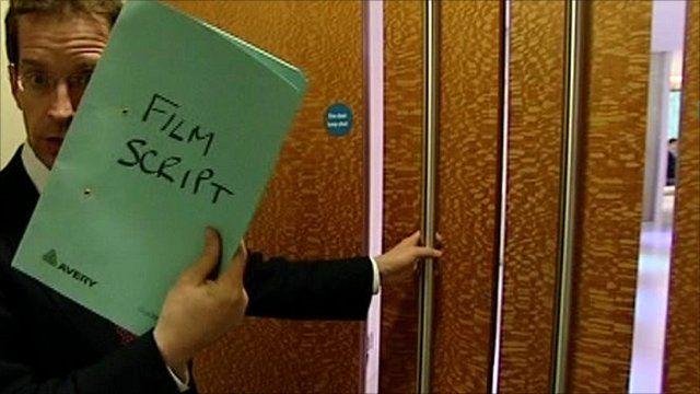 The BBC's David Sillito carrying a film script