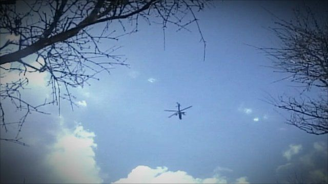 Pictures reportedly showing a helicopter attacking Libyan opposition