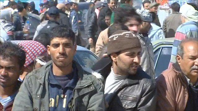 People continue to stream across the Libyan-Tunisia border