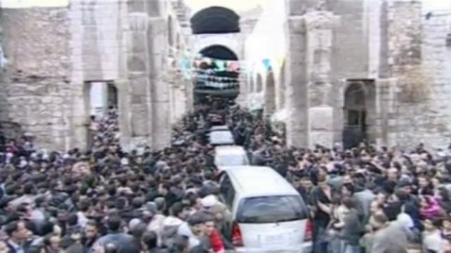 President Bashar al-Assad's car being mobbed by supporters
