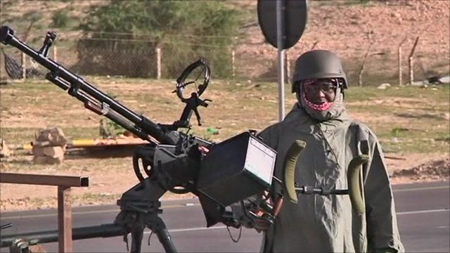 Man with large machine gun