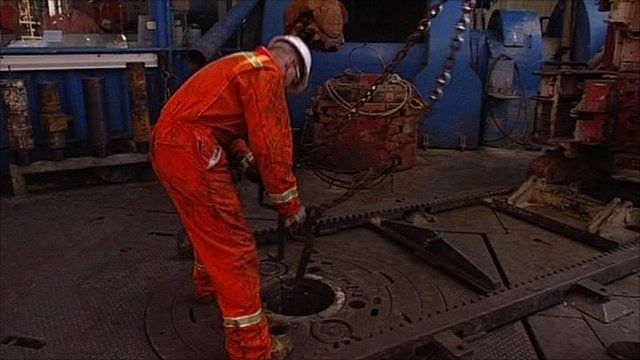Man drills for oil