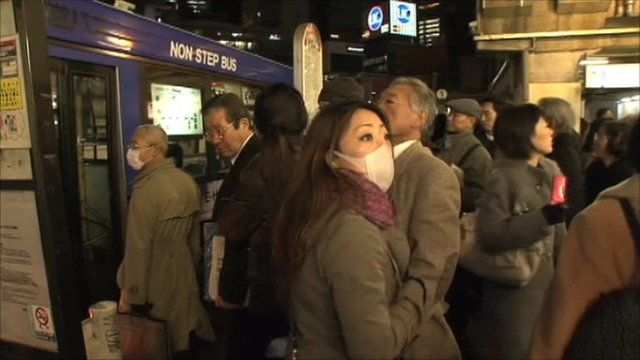 People stand in Tokyo street