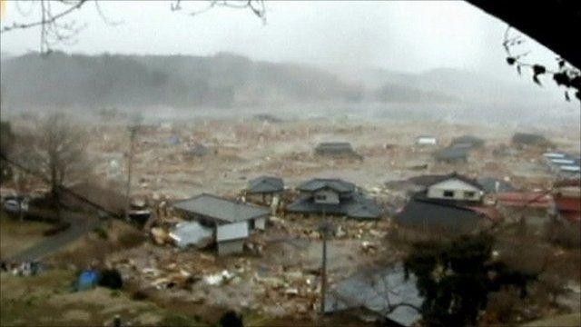 Tsunami washes away homes