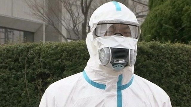 A man in protective clothing