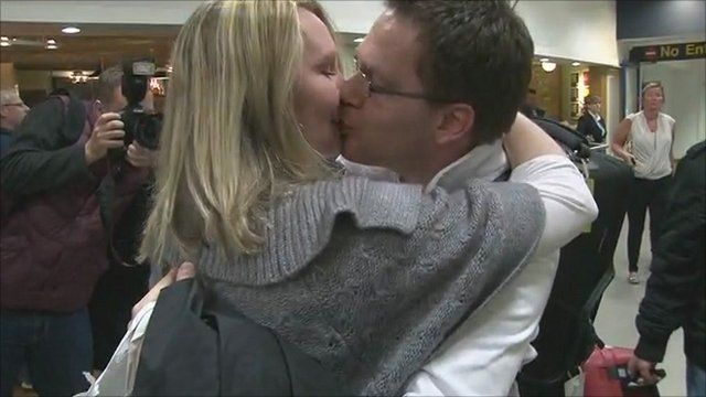 Trumpet player Jamie Prophet kisses his wife, Melody