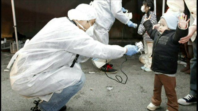 Child being checked for radiation