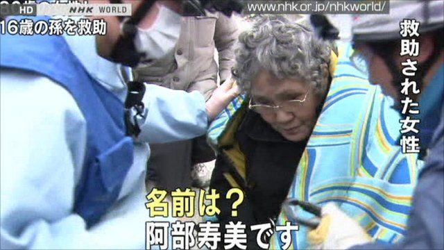 Japanese woman and rescuers