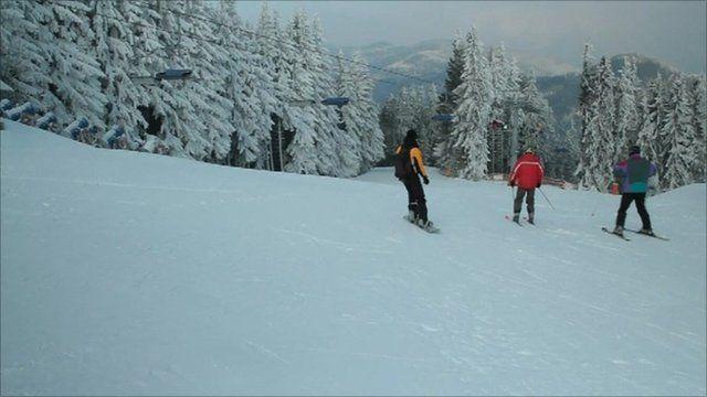 Ski slope with skiers